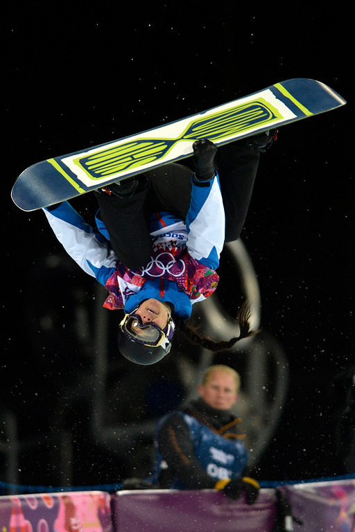 . France\'s Sophie Rodriguez makes a grab during a women\'s snowboard halfpipe final at the Rosa Khutor Extreme Park. Sochi 2014 Winter Olympics on Wednesday, February 12, 2014. (Photo by AAron Ontiveroz/The Denver Post)