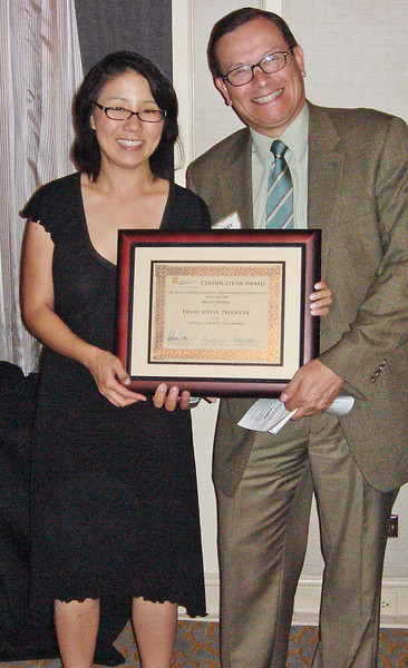 "Alina Kwak and Henry Servin, producers, hold the Media Award for the documentary film ""La Pulga: San Jose's Flea Market"""