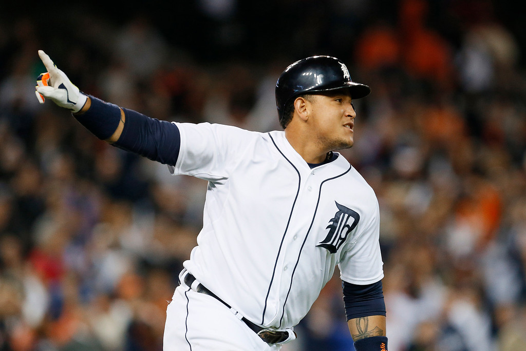 . Detroit Tigers\' Miguel Cabrera celebrates hitting a walk off one-run single against the Chicago White Sox in the ninth inning of a baseball game in Detroit Tuesday, Sept. 23, 2014. Detroit won 4-3. (AP Photo/Paul Sancya)