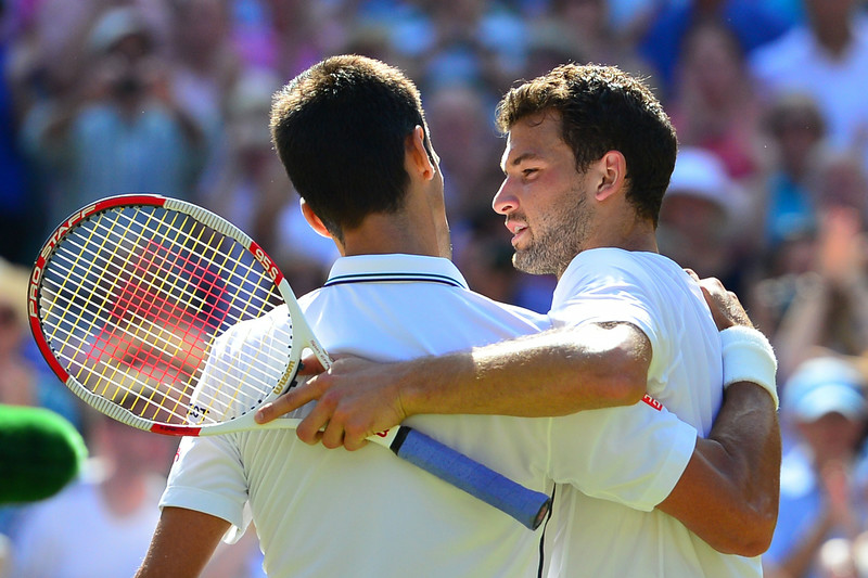. Serbia\'s Novak Djokovic (L) shakes hands with Bulgaria\'s Grigor Dimitrov after the former won their men\'s singles semi-final match on day 11 of  the 2014 Wimbledon Championships at The All England Tennis Club in Wimbledon, southwest London, on July 4, 2014. (CARL COURT/AFP/Getty Images)