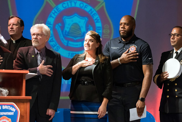 09/20/18 Wesley Bunnell | Staff The New Britain Fire Department held their 2018 Awards Ceremony on Thursday September 20 at Trinity on Main. Mayor Erin Stewart, middle, Chairman of the Fire Board Tremell Collins and Fire Chief Raul Ortiz during the Pledge of Allegiance.