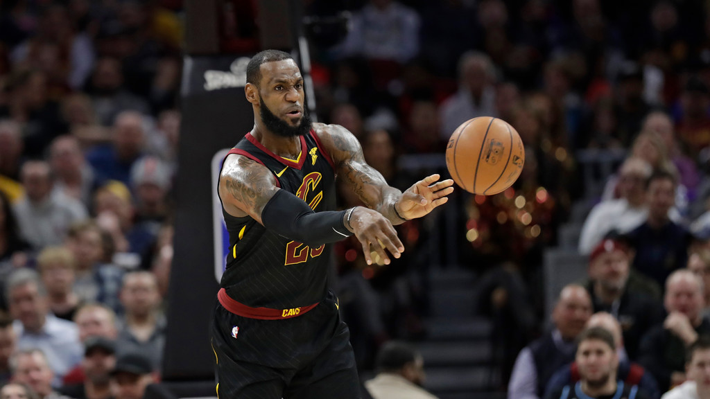. Cleveland Cavaliers\' LeBron James passes the ball in the first half of an NBA basketball game against the Washington Wizards, Thursday, April 5, 2018, in Cleveland. (AP Photo/Tony Dejak)