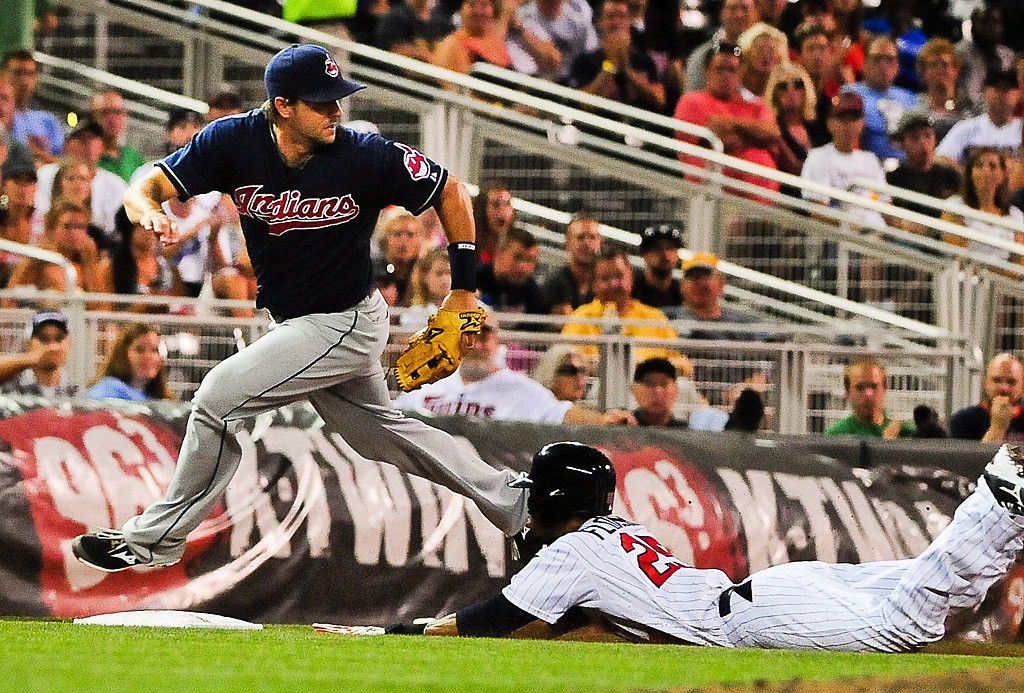 . Minnesota Twins shortstop Pedro Florimon, right, slides safely to third on a fielding error in the 6th inning. (Pioneer Press: Ben Garvin)