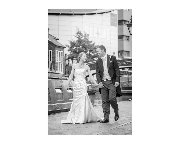 Wedding Photography of Hannah & Edward, Austin Court, Birmingham, Photograph is of the Bride & Groom walking along the canal side