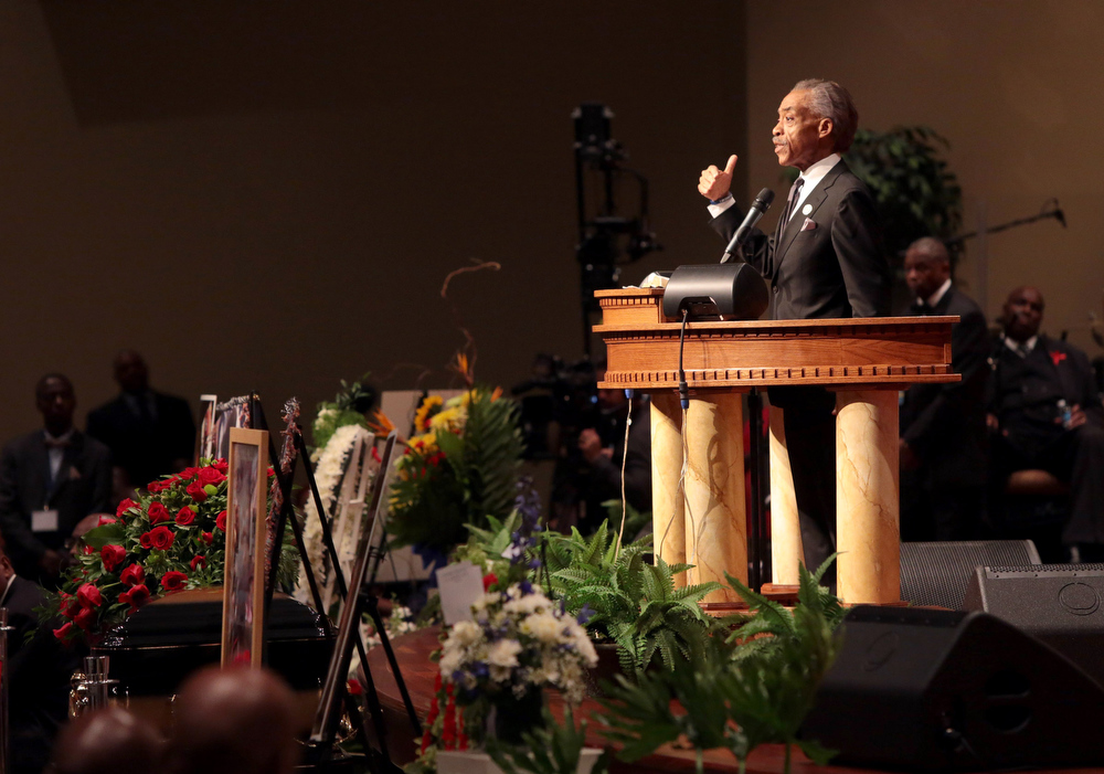 Description of . The Rev. Al Sharpton speaks during the funeral of Michael Brown inside Friendly Temple Missionary Baptist Church on August 25, 2014 in St. Louis Missouri. Michael Brown, an 18 year-old unarmed teenager, was shot and killed by Ferguson Police Officer Darren Wilson in the nearby town of Ferguson, Missouri on August 9. His death caused several days of violent protests along with rioting and looting in Ferguson.  (Photo by Robert Cohen-Pool/Getty Images)