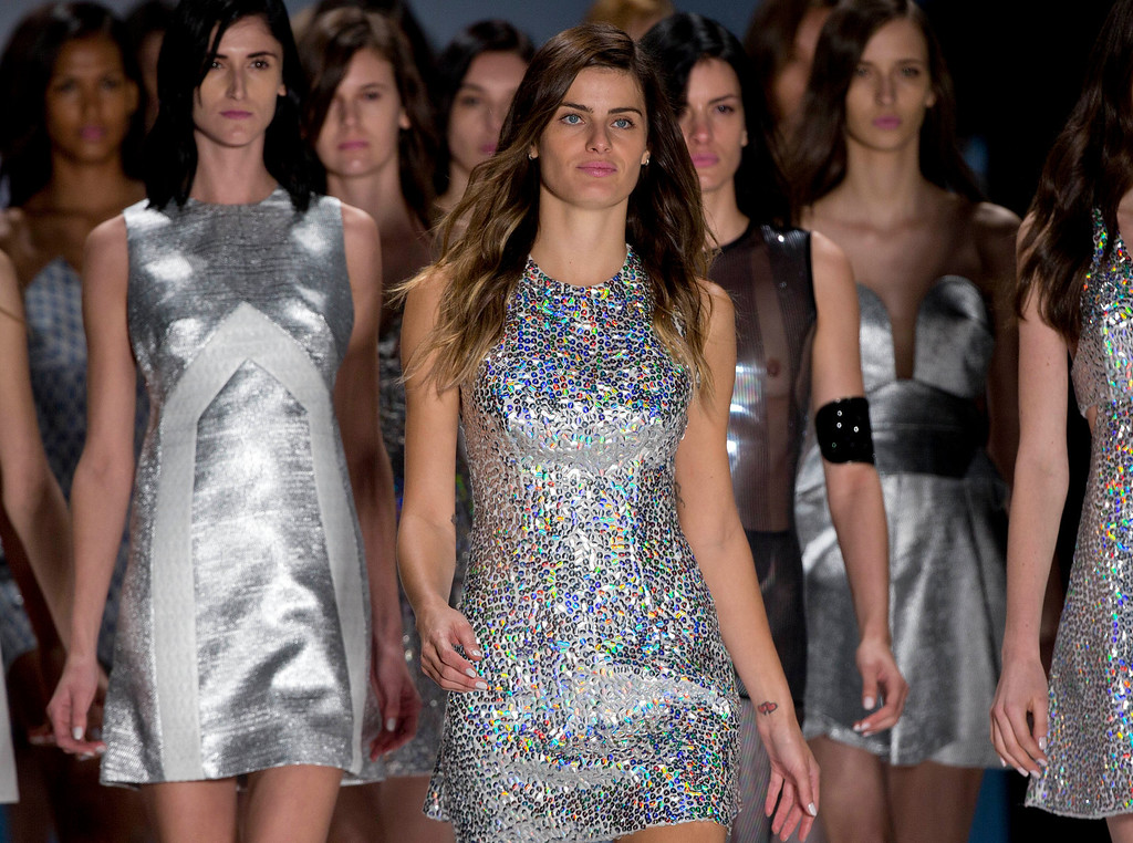 . Brazilian model Isabeli Fontana, front, and other models wear creations from the Tufi Duek Summer collection at Sao Paulo Fashion Week in Sao Paulo, Brazil, Monday, March 31, 2014. (AP Photo/Andre Penner)