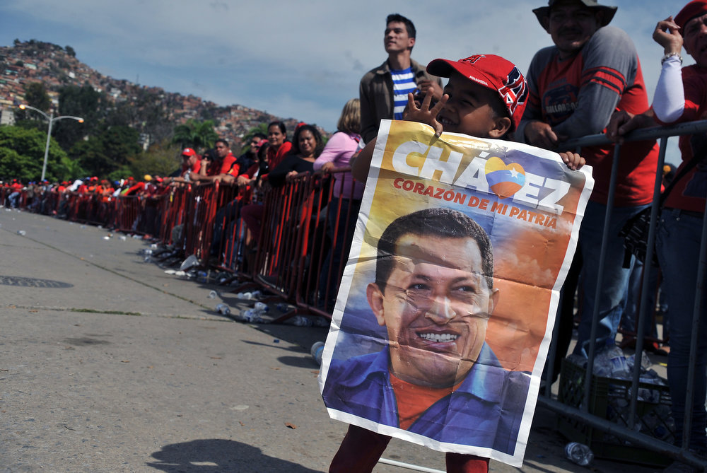 . Supporters of the late Venezuelan President Hugo Chavez queue outside the Military Academy chapel waiting to pay last respects to the leader on March 7, 2013 in Caracas. Venezuelans filed past the open casket of late President Hugo Chavez as he lay in state after throngs of weeping loyalists gave the firebrand leftist a rousing farewell on the streets on the eve. GUILLERMO LEGARIA/AFP/Getty Images