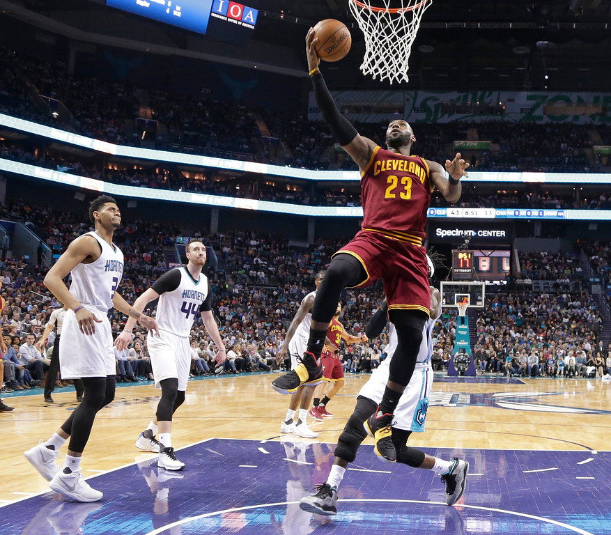. Cleveland Cavaliers\' LeBron James (23) drives to the basket against the Charlotte Hornets during the first half of an NBA basketball game in Charlotte, N.C., Friday, March 24, 2017. (AP Photo/Chuck Burton)