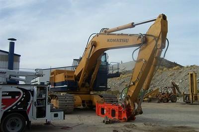 NPK E240A hydraulic hammer on Komatsu excavator.jpg
