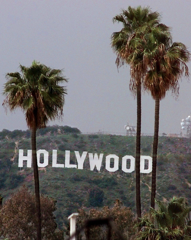 . Palm trees stand in front of the famed Hollywood sign, Saturday, April 24, 1999, in Los Angeles. (AP Photo/Mark J. Terrill)
