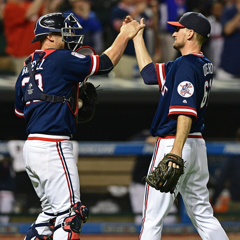 . Cleveland Indians relief pitcher Dan Otero, right, is congratulated by Chris Gimenez after they defeated the Kansas City Royals in a baseball game, Saturday, June 4, 2016, in Cleveland, Ohio. (AP Photo/David Dermer)