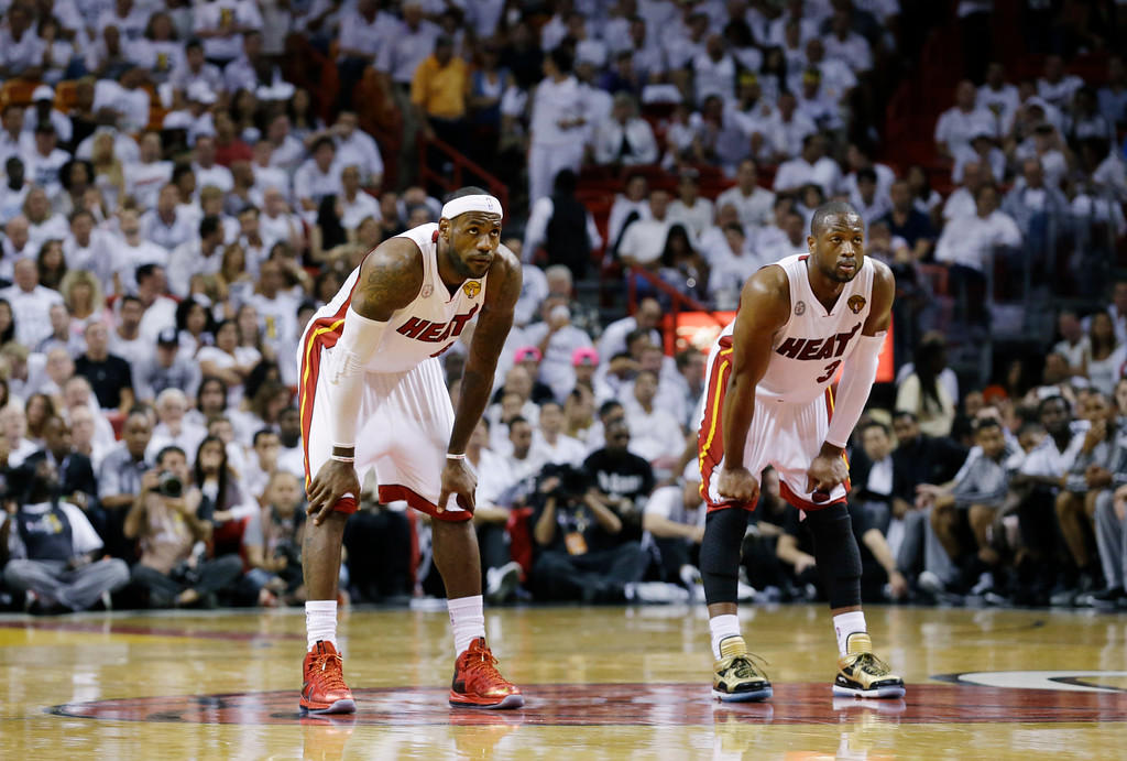. Miami Heat\'s LeBron James, left, and Dwyane Wade pause during the second half in Game 7 of the NBA basketball championships against the San Antonio Spurs, Thursday, June 20, 2013, in Miami. (AP Photo/Lynne Sladky)