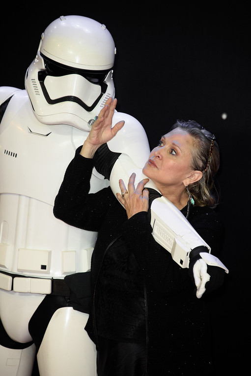 . Carrie Fisher poses for photographers upon arrival at the European premiere of the film \'Star Wars: The Force Awakens \' in London, Wednesday, Dec. 16, 2015. (Photo by Jonathan Short/Invision/AP)