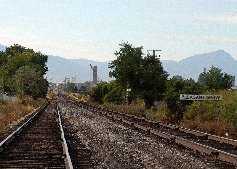 This is one of those random images that just works. I shot it from my car as I crossed the railroad tracks without looking through the viewfinder. I then gave it a watercolor treatment in Photoshop.
