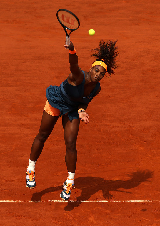 . Serena Williams of United States of America serves in her Women\'s Singles Final match against Maria Sharapova of Russia  during day fourteen of French Open at Roland Garros on June 8, 2013 in Paris, France.  (Photo by Matthew Stockman/Getty Images)