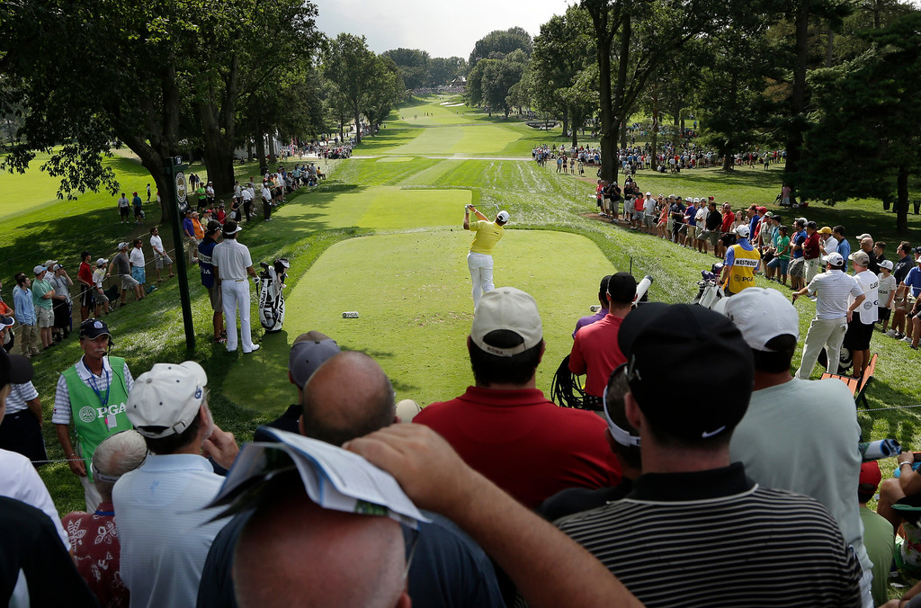 . Lee Westwood, of England, hits his tee shot on the 13th hole during the first round of the PGA Championship golf tournament at Oak Hill Country Club, Thursday, Aug. 8, 2013, in Pittsford, N.Y. (AP Photo/Charlie Riedel)