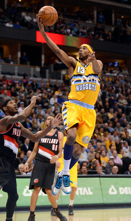 . Denver Nuggets small forward Corey Brewer (13) gets an easy layup against the Portland Trail Blazers during the first quarter  Tuesday, January 15, 2013, at Pepsi Center. John Leyba, The Denver Post