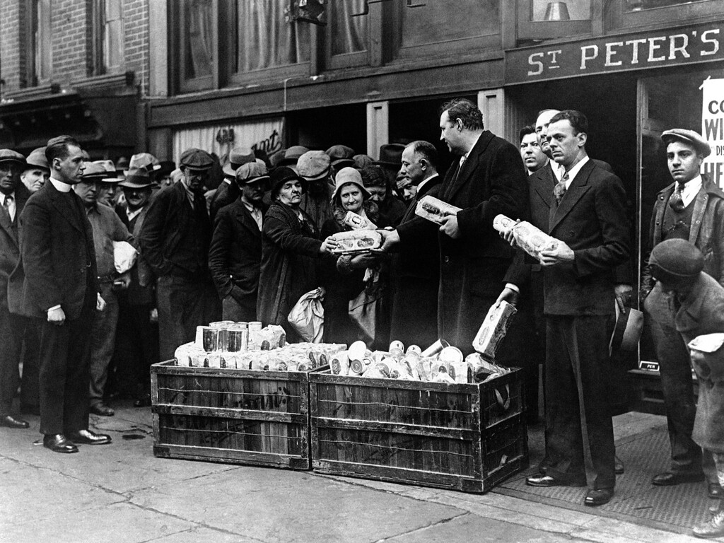 . Unemployed people receive bread and milk in New York, USA around Jan. 23, 1931. (AP Photo)