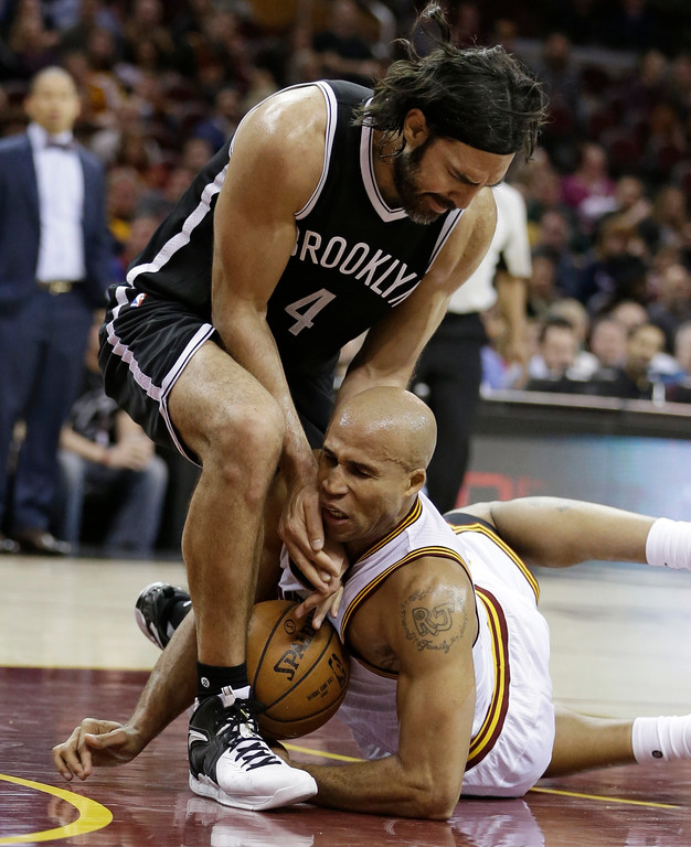 . Cleveland Cavaliers\' Richard Jefferson, bottom, and Brooklyn Nets\' Luis Scola compete for a loose ball during the second half of an NBA basketball game, Friday, Jan. 27, 2017, in Cleveland. (AP Photo/Tony Dejak)