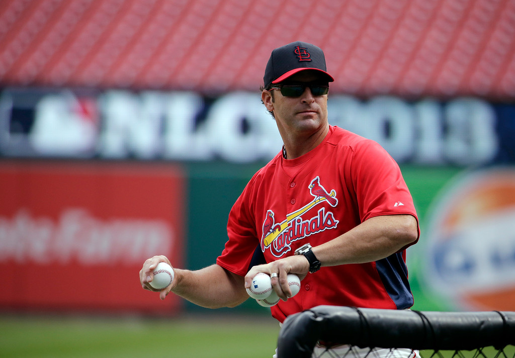 . St. Louis Cardinals manager Mike Matheny throws batting practice before Game 2 of the National League baseball championship series against the Los Angeles Dodgers Saturday, Oct. 12, 2013, in St. Louis. (AP Photo/Chris Carlson)