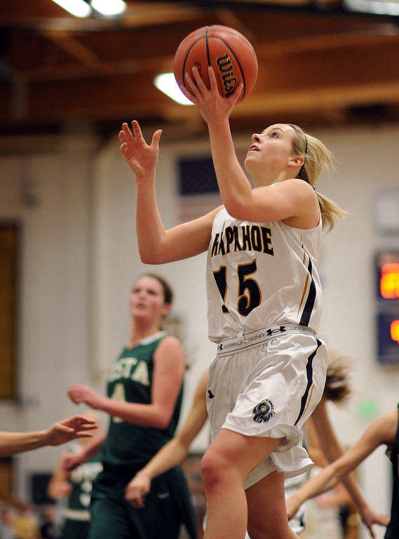 . Arapahoe\'s Carly Buechler (15) drives the ball against Mountain Vista defense in the first half of the game at Arapahoe High School Gym onSaturday, Jan. 5, 2013, in Centennial, Colo. Arapahoe won 74-38. Hyoung Chang, The Denver Post