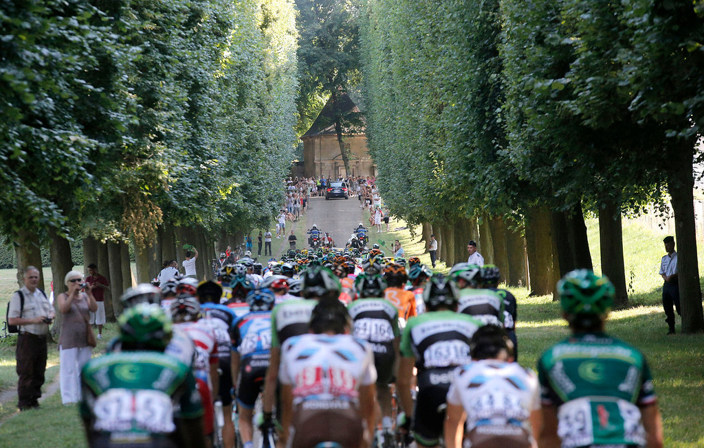. The pack rides through the alleys of the Versailles castle during the 21st and last stage of the 100th edition of the Tour de France cycling race over 133.5 kilometers (83.4 miles) with start in Versailles and finish in Paris, France, Sunday July 21 2013. (AP Photo/Christophe Ena)