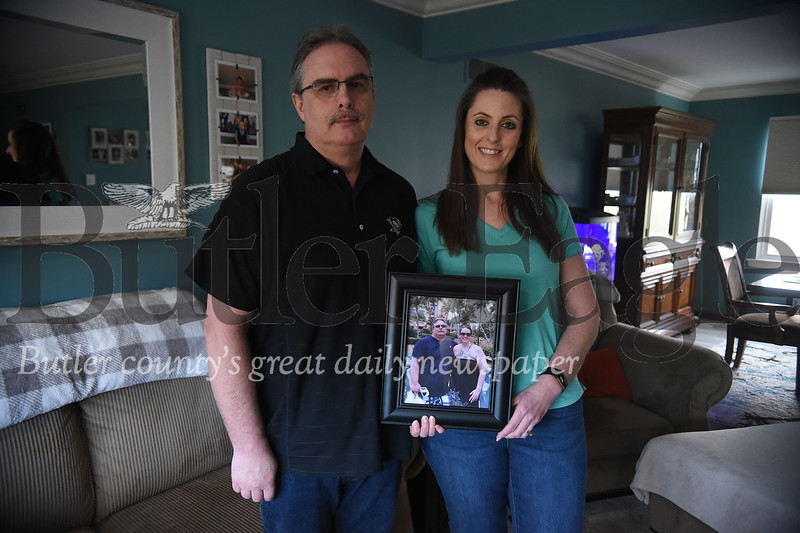 0458: Mike and Lori Noble stand with a photo of themselves from before significant weight loss aided by gastric sleeve surgeries. Justin Guido/Butler Eagle
