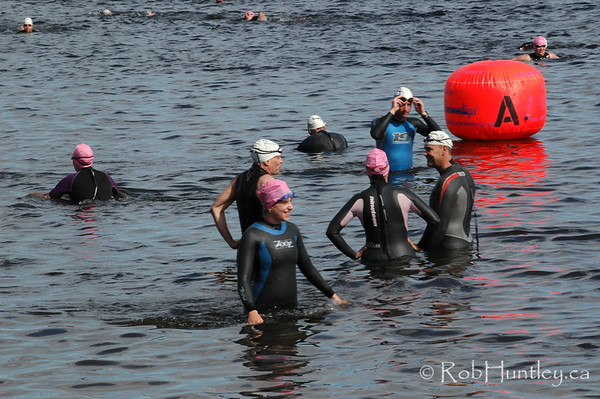 2009 Ottawa Riverkeeper Triathlon. Getting acclimatized to the cold water before the start of a race. Earlier race ongoing in the background.  © Rob Huntley