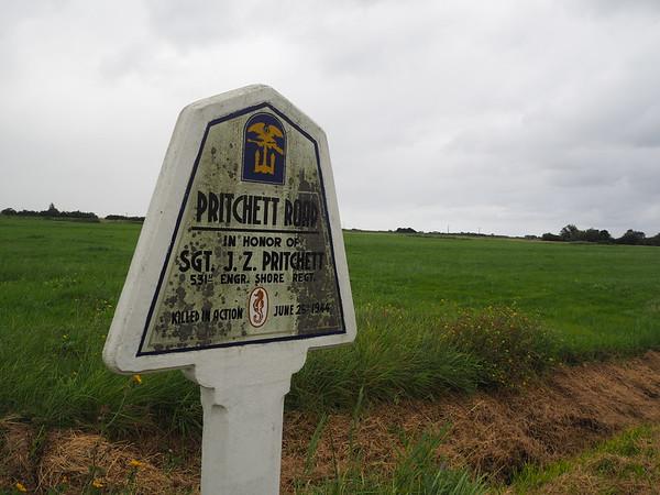 Memorial road sign for Sgt J. Z. Pritchett, killed in action 25 June 1944