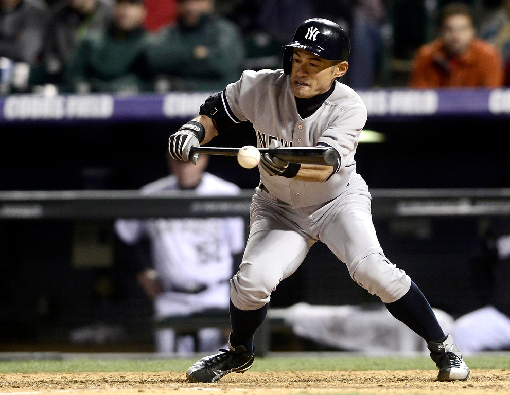 . New York Yankees\' Ichiro Suzuki bunts, leading to the game winning run to third base, against the Colorado Rockies\' during their inter-league MLB baseball game in Denver, Colorado May 8, 2013.   REUTERS/Mark Leffingwell