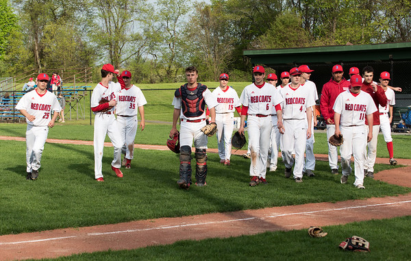 05/6/19 Wesley Bunnell | Staff Berlin baseball defeated Bristol Eastern at Sage Park on Tuesday afternoon. The Redcoat team walks back to the dugout after shaking hands with Bristol Eastern.