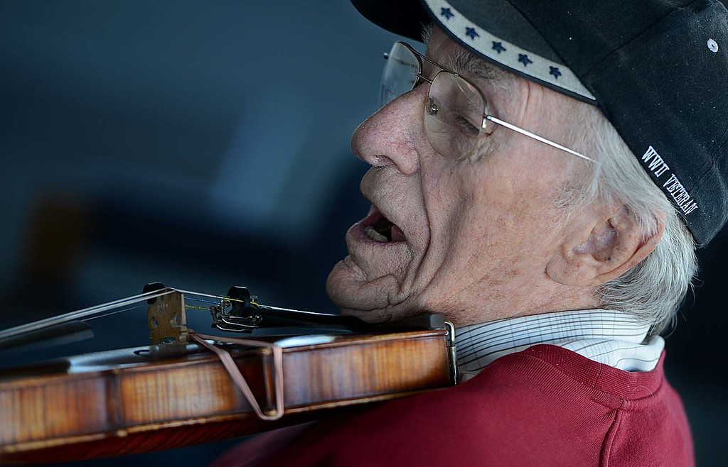 ". Bill Williams, 91, plays the violin with a group of fellow World War II Veterans. The Redlands Airport Philharmonic gather each Wednesday in the lobby of the Redlands Airport to share stories, coffee, donuts and ""Just to jam.\"" Says keyboardist Lew Lemon, 87. (Staff photo by Rick Sforza/Redlands Daily Facts)"