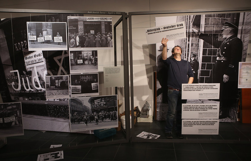 ". A museum worker assembles the final exhibits at the exhibition ""Berlin 1933 - The Path To Dictatorship\"" at the Topography of Terror documentation center and museum on January 29, 2013 in Berlin, Germany. The exhibition, which opens officially tomorrow, examines the period in 1933 shortly after Adolf Hitler assumed power and the Nazis began murdering and intimidating political opponents as well as persecuting Jews. 2013 marks the 80th anniversary of the Nazi assumption of power.  (Photo by Sean Gallup/Getty Images)"