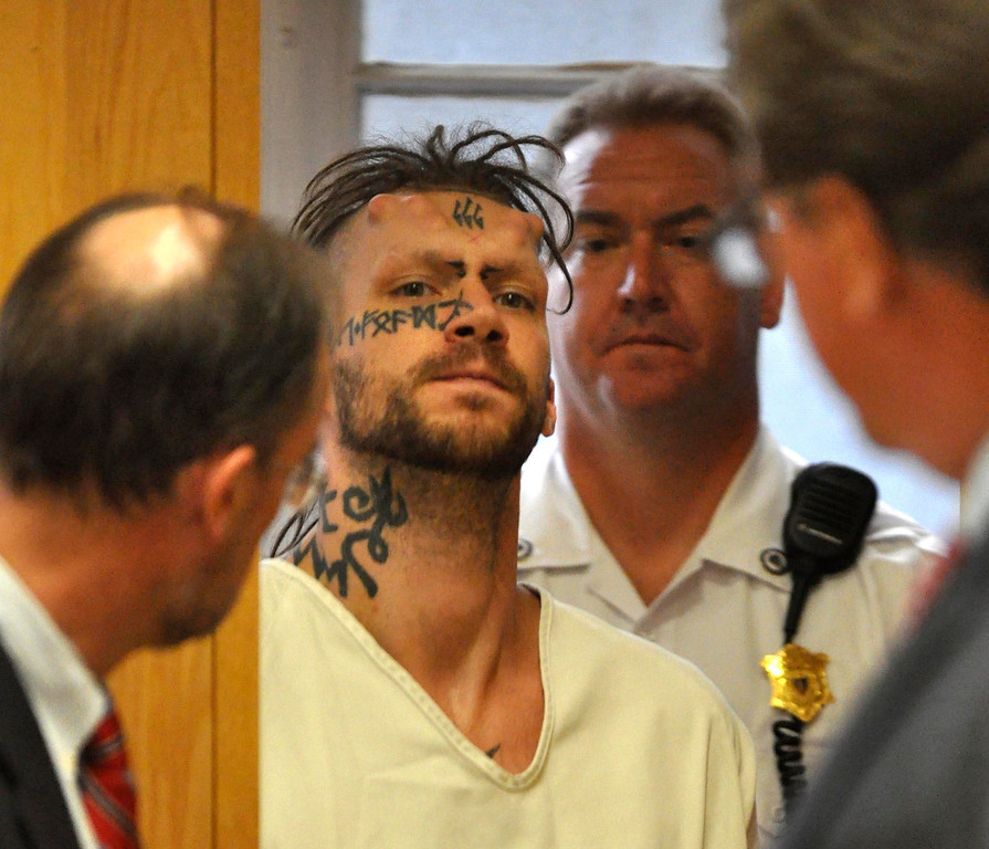. Caius Veiovis, 31, is arraigned in Berkshire District Court on charges of murder and kidnapping of three Pittsfield, Ma men.  CHalue was charged with Adam Lee Hall and David Chalue after the bodies of David Glasser, Edward Frampton and Robert Chadwell were discovered over the weekend.  Pittsfield, Monday September 12, 2011 (Ap Photo by Ben Garver, The Berkshire Eagle)