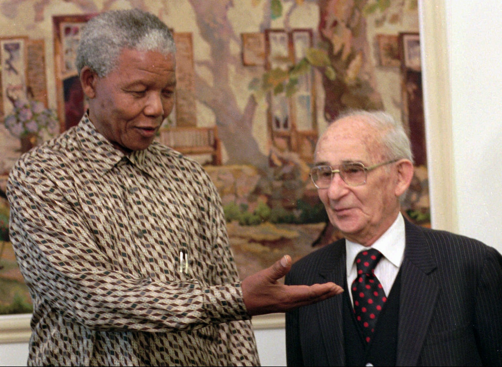 . South African President Nelson Mandela, left, gestures to Percy Yutar, the former state prosecutor who sent Mandela to jail for life, 31 years ago for plotting sabotage against the white minority rule in South Africa.  The pair is seen prior to their luncheon at the President\'s residence in Pretoria, Thursday November 23, 1995. It was Mandela latest effort to bring reconciliation to South Africa. (AP Photo/Adil Bradlow)