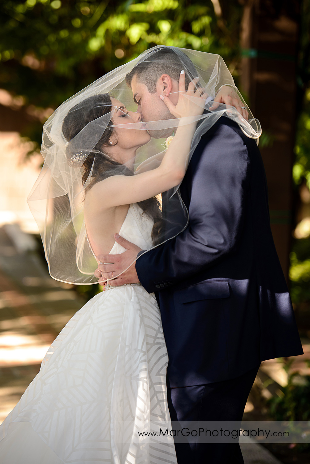 bride and groom kissing under veil at Saratoga Foothill Club
