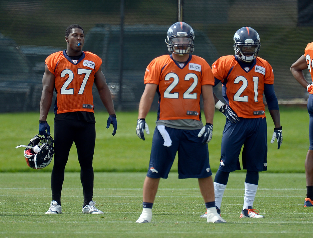 . Denver Broncos running back Knowshon Moreno (27) and Denver Broncos running back Ronnie Hillman (21) look on as Denver Broncos running back Jacob Hester (22) prepares to run a play during practice August 23, 2013 at Dove Valley (Photo by John Leyba/The Denver Post)