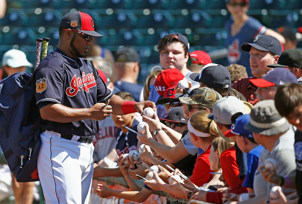 . Cleveland Indians\' Edwin Encarnacion signs autographs prior to a spring training baseball game against the Oakland Athletics Thursday, March 16, 2017, in Goodyear, Ariz. The Indians defeated the Athletics 6-5. (AP Photo/Ross D. Franklin)