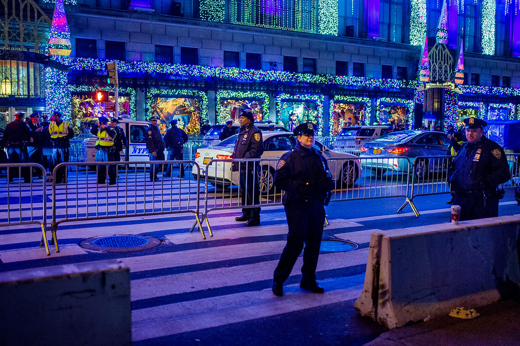 . Police stand guard and control the traffic near Rockefeller Center during the 85th annual Rockefeller Center Christmas tree lighting ceremony, Wednesday, Nov. 29, 2017, in New York. (AP Photo/Andres Kudacki)