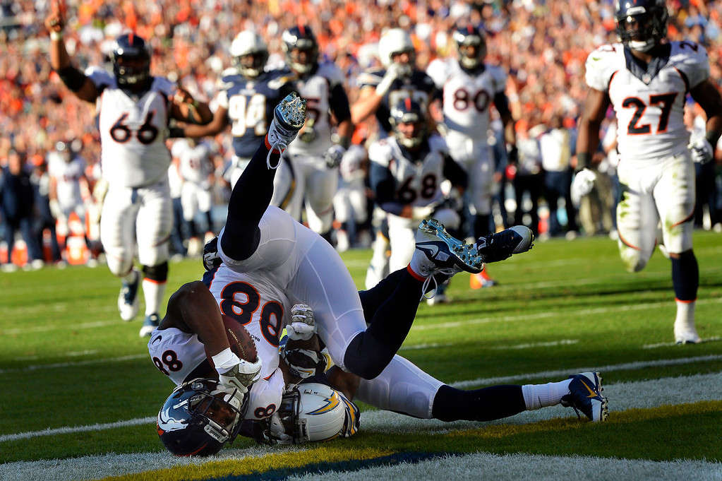 . Wide receiver Demaryius Thomas #88 of the Denver Broncos rolls in the end zone to make the score 20 -6 with 13 seconds left in the 2nd quarter vs the San Diego Chargers at Qualcomm Stadium November 10, 2013 San Diego, CA. (Photo By Joe Amon/The Denver Post)
