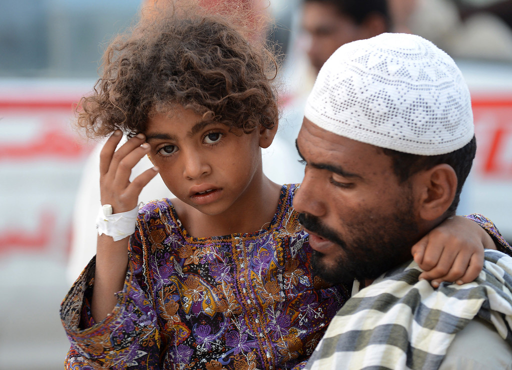 . A Pakistani earthquake survivor carries his injured girl outside a hospital in the devastated district of Awaran on September 28, 2013. A 6.8-magnitude earthquake hit southwest Pakistan Saturday in a region already devastated by a quake which left more than 300 dead just days ago.  BANARAS KHAN/AFP/Getty Images