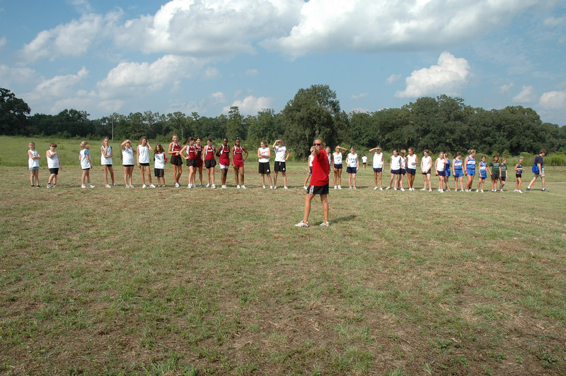 Getting ready: HCES Super-Coach L.A. Hanlon instructs the runners before the start of the Girls' 1.5M race.
