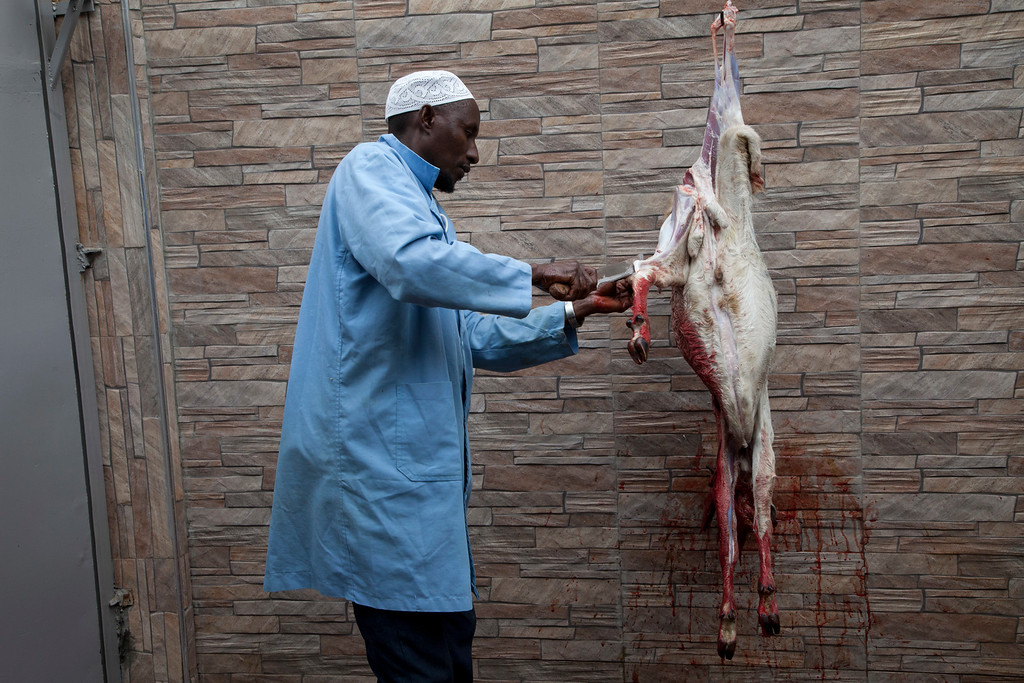 . A Butcher skins a goat to distribute the meat to the poor people during the celebration of Eid al-Adha, or Feast of Sacrifice, that commemorates the Prophet Ibrahim\'s faith, in Nairobi, Kenya, Monday, Sept. 12, 2016. Eid al-Adha marks the end of hajj. (AP Photo/Sayyid Abdul Azim)