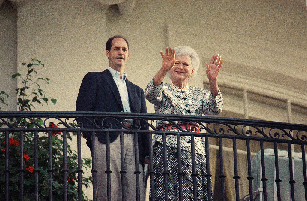 . First Lady Barbara Bush with her Nephew Kent Pierce waves from a balcony at the White House on Monday, Sept. 18, 1989 in Washington as President Bush departs by helicopter from the South Lawn heading for a three state two day trip west.(AP Photo/Bob Daugherty
