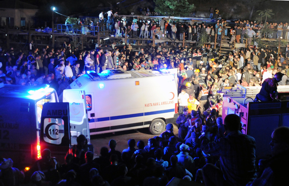 . Medics, ambulances and relatives at the entrance of the mine hours after an explosion and fire at a coal mine killed at least 17 miners and left up to 300 workers trapped underground, in Soma, in western Turkey, late Tuesday, May 13, 2014, a Turkish official said. (AP Photo/Depo Photos)