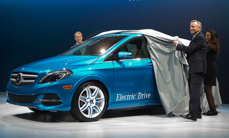 . Stephen Cannon, left, president and CEO Mercedes Benz USA, and Joachim Schmidt,  Executive VP for Sales and Marketing of Mercedes-Benz Cars, unveil the 2014 B-Class Electric Drive Mercedes Benz at the New York International Auto Show, in New York\'s Javits Center,  Wednesday, March 27, 2013. (AP Photo/Richard Drew)