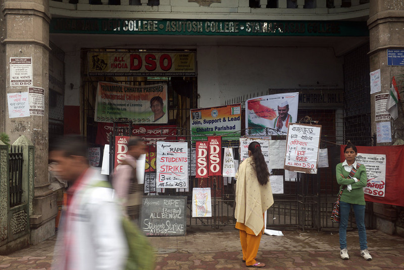 . Pedestrians and students are seen in front of placards, calling for a statewide student strike against rape, in front of a government college in Kolkata on January 3, 2013. Protesters have massed in Indian cities daily since the December 16 assault demanding the government and police take sex crime more seriously, with tougher penalties for offenders and even chemical castration being considered. Indian police formally charged five men with murder, kidnapping and rape January 3 in a New Delhi court over the fatal gang-raping of a woman that has appalled the nation. DIBYANGSHU SARKAR/AFP/Getty Images
