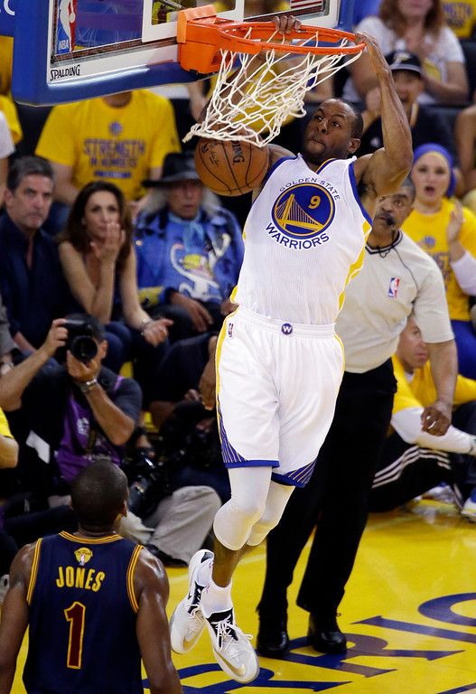 . Golden State Warriors forward Andre Iguodala (9) dunks against Cleveland Cavaliers forward James Jones (1) during the first half of Game 2 of basketball\'s NBA Finals in Oakland, Calif., Sunday, June 7, 2015. (AP Photo/Eric Risberg)