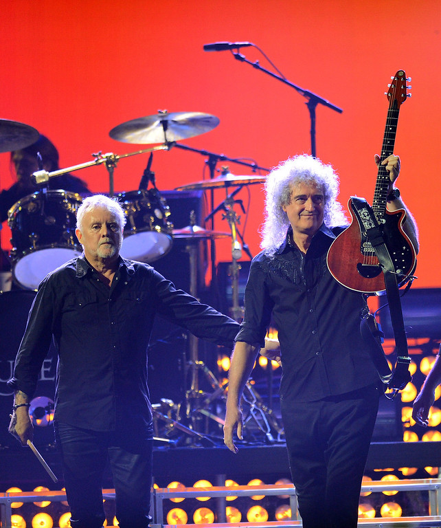 . Drummer Roger Taylor (L) and guitarist Brian May of Queen perform during the iHeartRadio Music Festival at the MGM Grand Garden Arena on September 20, 2013 in Las Vegas, Nevada.  (Photo by Ethan Miller/Getty Images for Clear Channel)