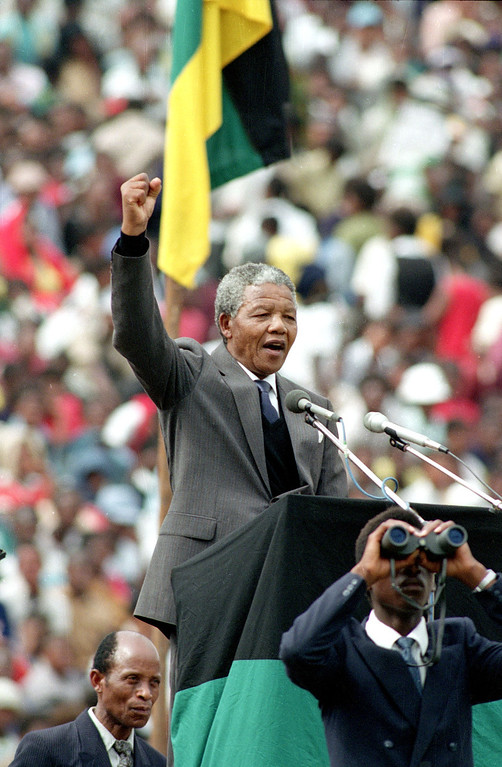 . In this Feb. 13, 1990 file photo, ANC leader and symbol of resistance to apartheid, Nelson Mandela,  is seen as he gives the black power salute to the 120,000 ANC supporters packing Soweto\'s Soccer City stadium in Soweto, near Johannesburg, South Africa, shortly after his release from 27 years in prison.  (AP Photo, file)
